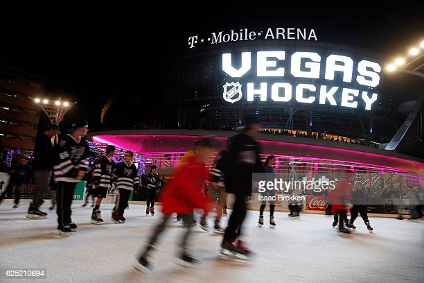 Children skate on an ice rink before the unveiling of the new logo and name for the Vegas Golden Knights in Toshiba Plaza at TMobile Arena November...