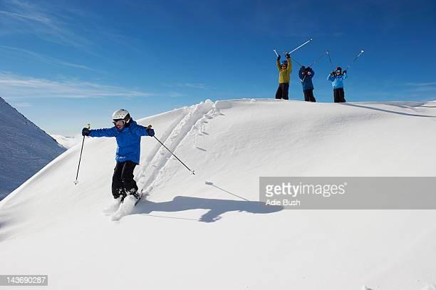 Children skiing on snowy mountainside