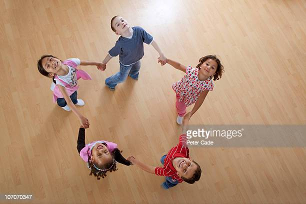children skipping aroung in a circle
