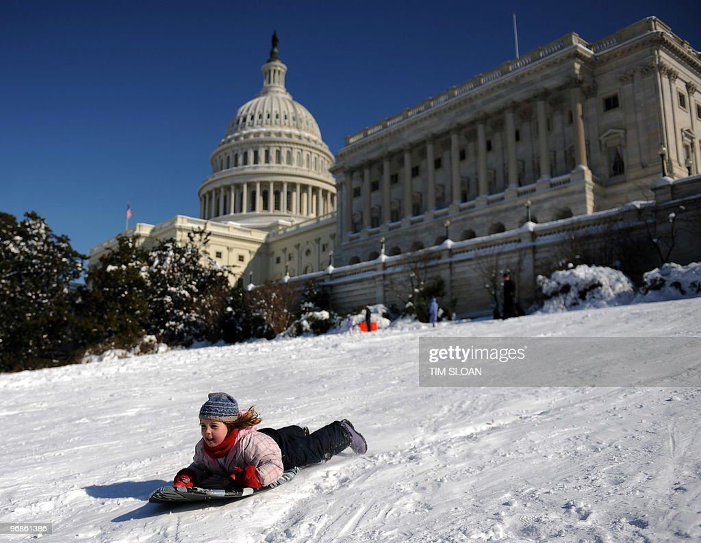 Children sled down Capitol Hill in Washington DC on February 8 2010 as the District of Columbia and the midAtlantic region recover from a weekend...