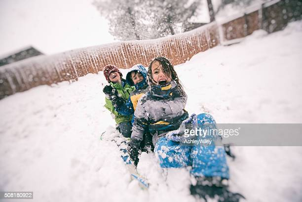 Children sled during a big winter snow storm