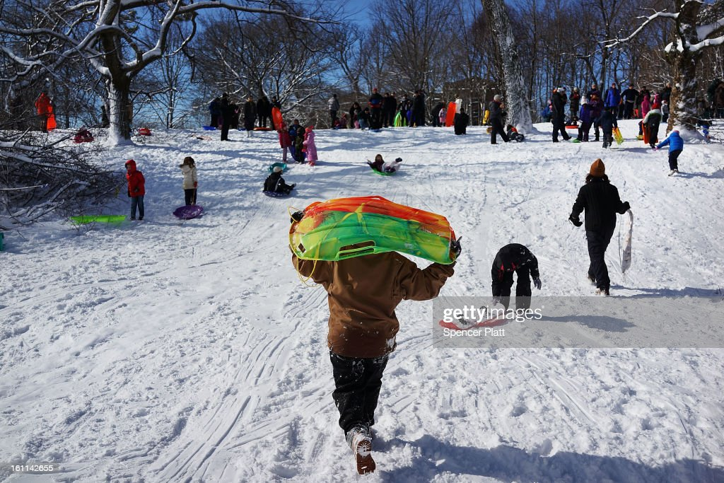 Children sled in Prospect Park in Brooklyn the morning after a massive snow storm on February 9, 2013 in New York City. New Yorkers woke up to over 10 inches of snow Saturday morning while parts of New England received over thirty inches following a storm that brought high winds and blizzard like conditions to the region.