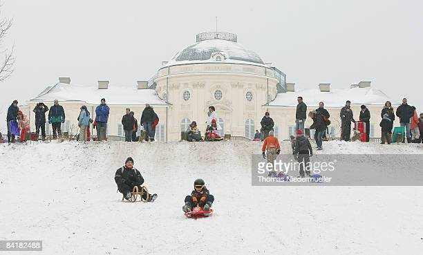 Children sledge down a snow covered hill at castle Solitude on January 6 2009 in Stuttgart Germany