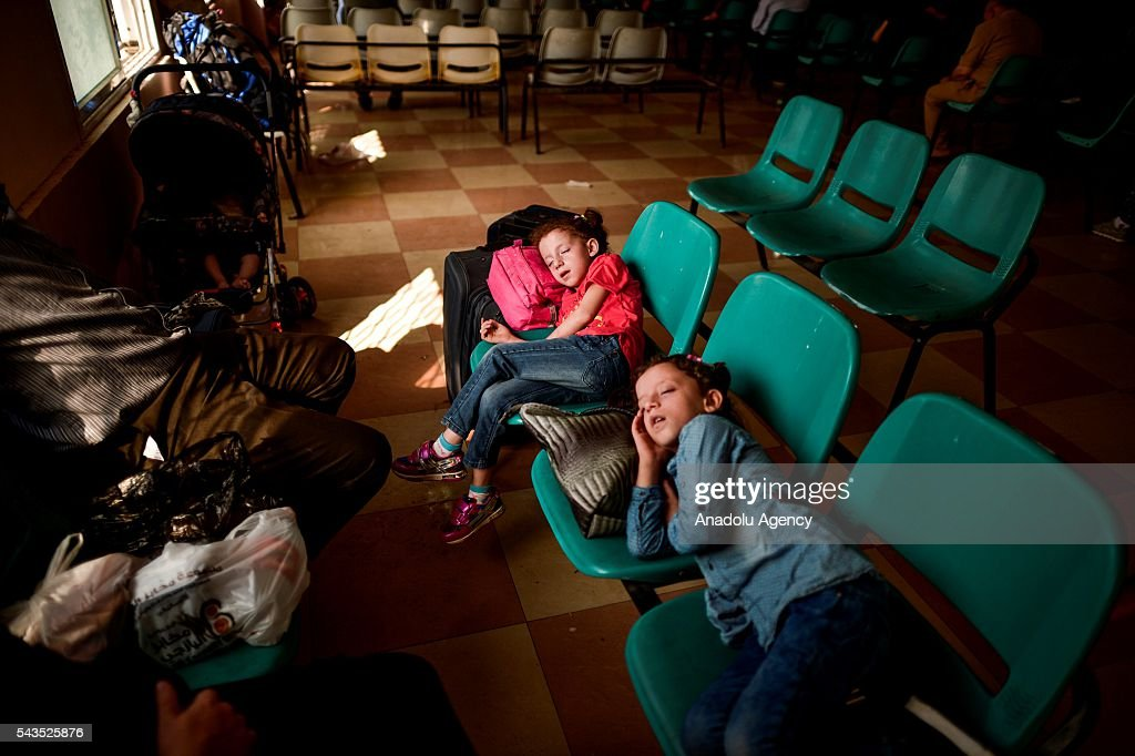 Children sleep on the seats at the Rafah border gate, which is Gaza's only access to the outside world, after Egyptian authorities temporarily reopened it both directions in Gaza Strip, Gaza on June 29, 2016. Students, patients, people with residence permit and passport owners are allowed to cross to border.