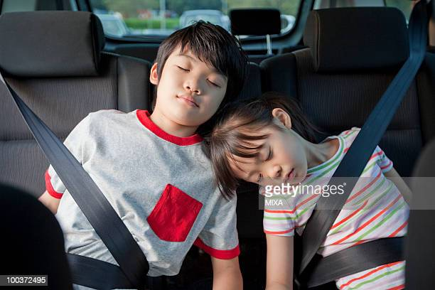 Children Sleeping in a Car