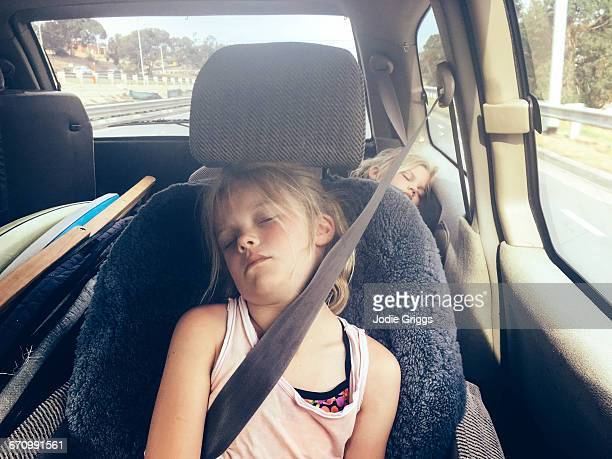 Children sleeping in the car after a day at beach