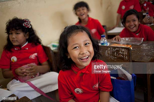 Children smile as they listen to an explanation from a trainee about washing hand on Global Handwashing Day on October 15 2012 in Jakarta Indonesia...