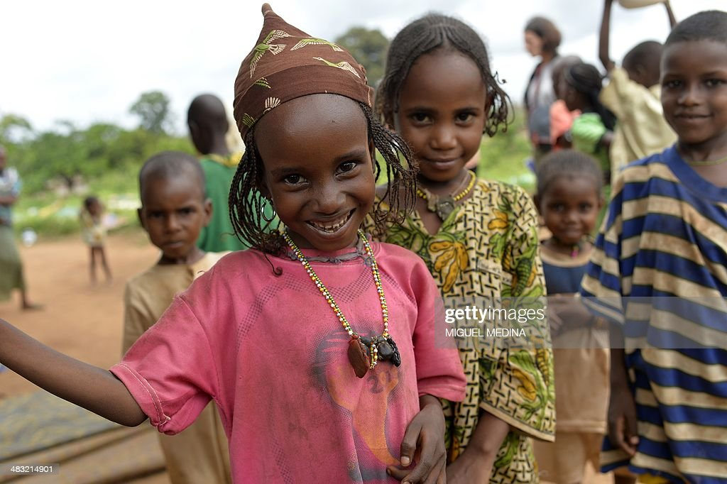 Children smile in the village of Boda on April 7, 2014. Pulaar ethnic and muslim community are trapped in the village of Boda surrounded by the Anti-Balaka militia and protected by the French Sangaris forces and African Misca forces. The crisis in the strife-torn Central African Republic, where thousands have been killed in sectarian violence, is threatening food security for 1.6 million people, the UN said on April 7.