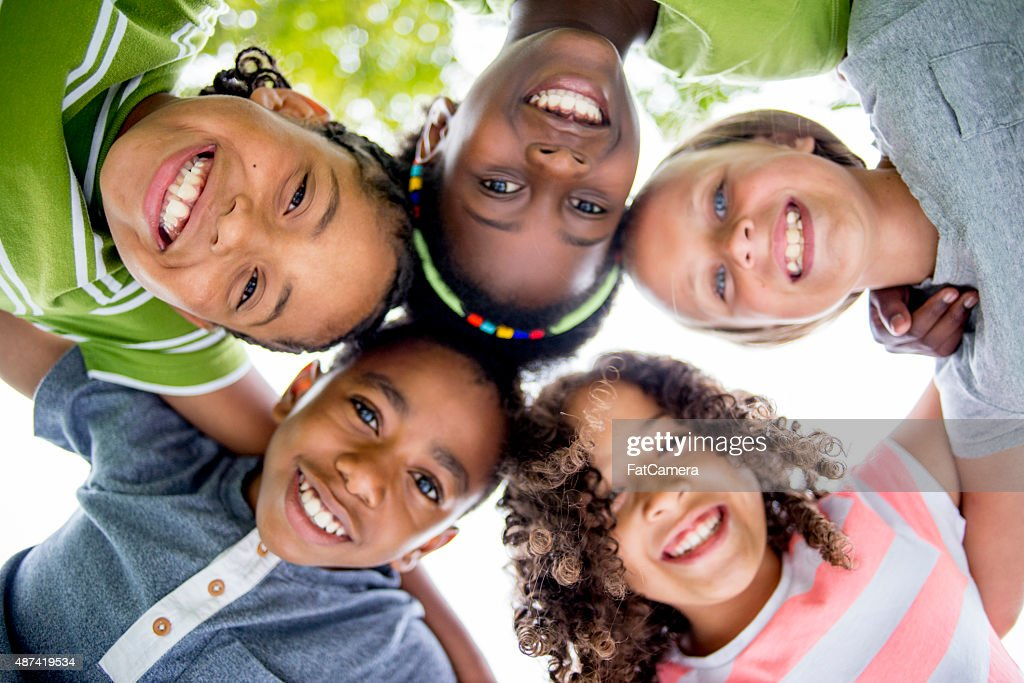 Children Smiling in a Huddle : Stock Photo