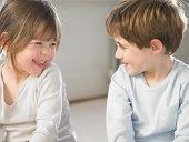 Children smiling together indoors