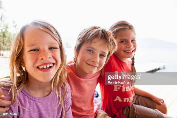 Children smiling together outdoors
