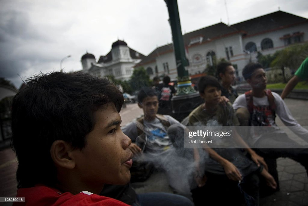 Children smoke while relaxing in a public area on January 24, 2011 in Yogyakarta, Indonesia. It is estimated that over 25 percent of children in Indonesia over the age of three have tried smoking, with over three percent of them smoking regularly. The lack of government regulation around advertising is blamed for the problem, with campaigns seen heavily at sporting events, music concerts. The Indonesian government previously passed a health bill in 2009 to address the issues, but it has not yet been implemented.