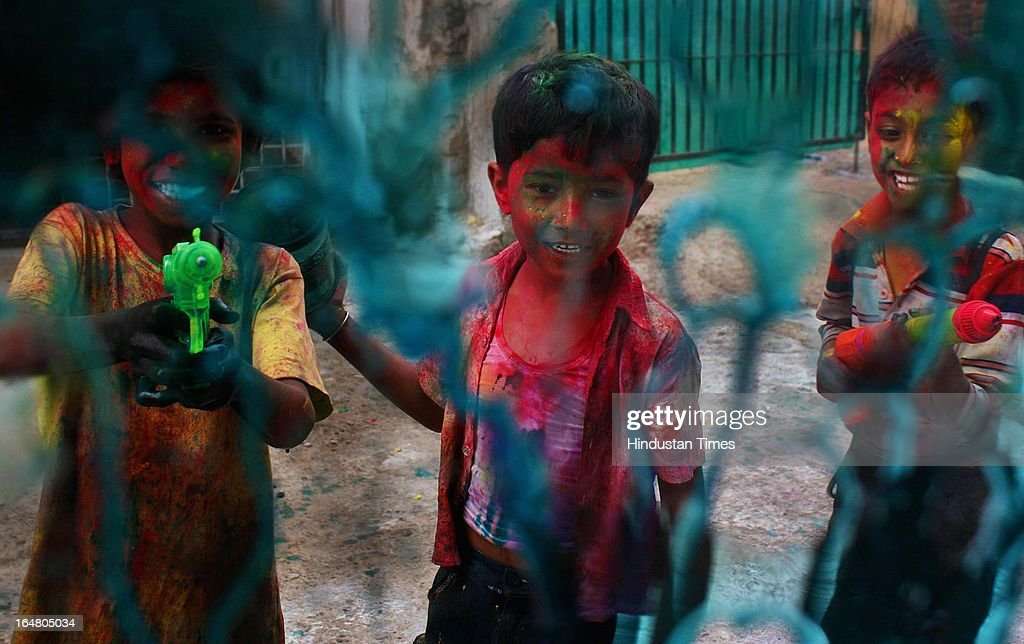 Children splash water colors on the eve of Holi celberation at Malviya Nagar. Holi marks the arrival of spring & end of the winter season. Holi, festival of color is Hindu religious festival also called Basantotsav or spring festival as it mark the arrival of spring. People gather together to play colors, sing and dance to traditional tunes and eat sweets specially Gujiyas.