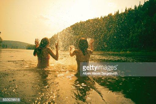 Children splashing in lake