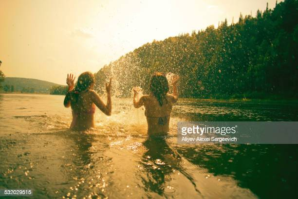 Children splashing in lake