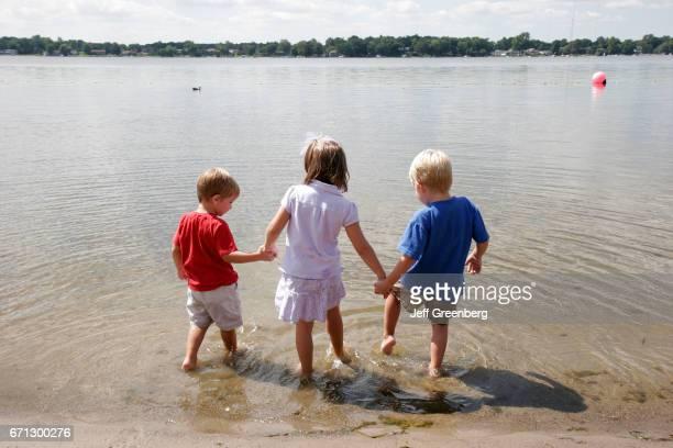 Children splashing in Winona Lake Park
