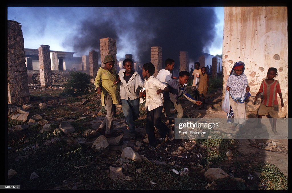 Children stand in a destroyed structure January 15 1993 in Baidoa Somalia US troops arrived in 1992 marking the beginning of a UN peacekeeping...