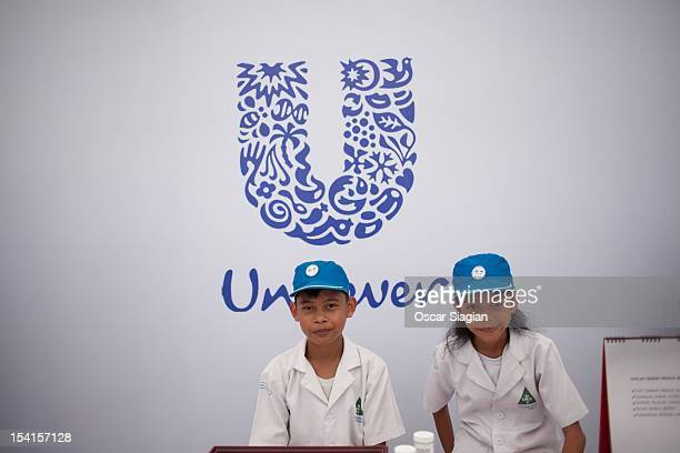 Children stand in front of a Unilever stand on Global Handwashing Day on October 15 2012 in Jakarta Indonesia Celebrated in over 100 countries Global...