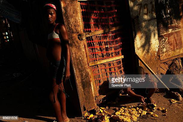 Children stand in the poverty ridden City of God favela or slum on December 2 2009 in Rio de Janeiro Brazil The favela which acclaimed international...