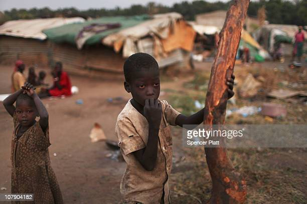 Children stand near their home in the southern Sudanese city of Juba January 6 2011 in Juba Sudan One of the world's poorest countries Sudan is...