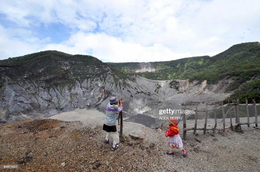 Children stand on the edge of the crater of Tangkubanparahu volcano near Bandung on February 22, 2009. Tangkubanparahu is an active stratovolcano, one of 129 active volcanos in Indonesia. Tangkubanparahu has erupted about 17 times since 1826.