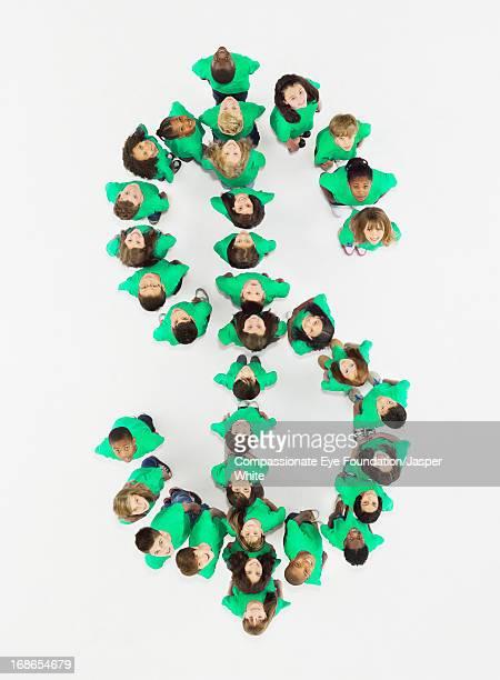 Children standing in Dollar sign formation