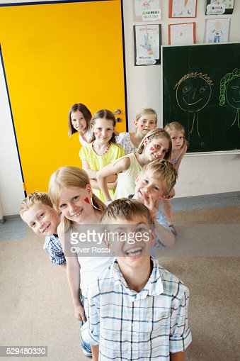 Children standing in line in classroom : Stock Photo
