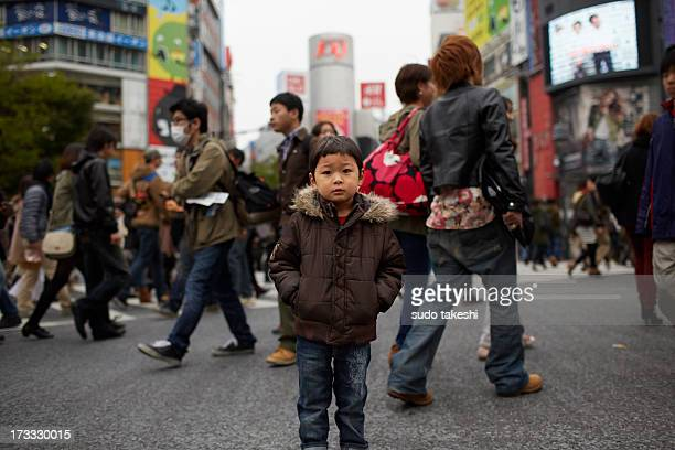 Children standing in the crowd of Tokyo.