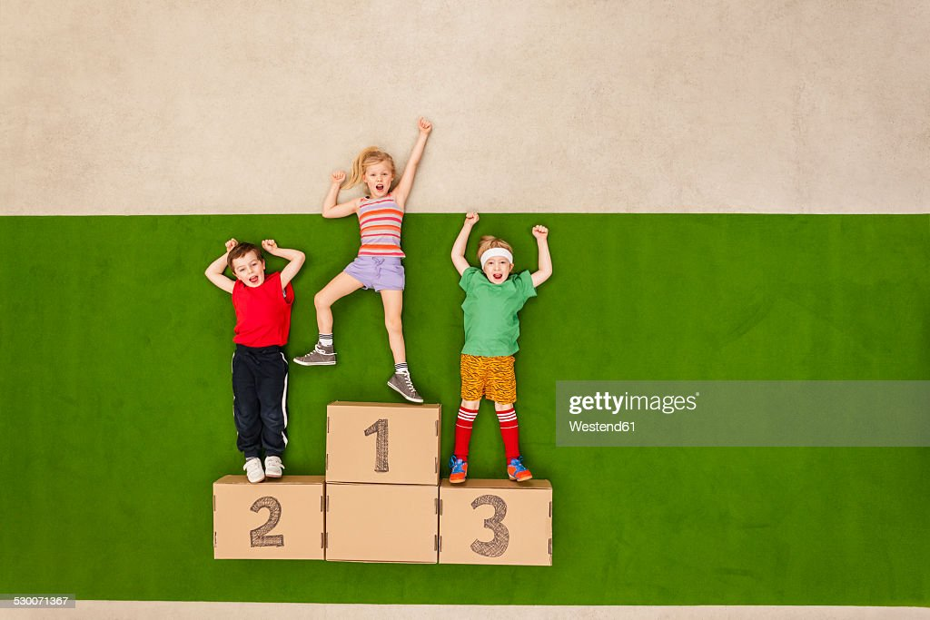 Children standing on podium