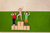 Children standing on podium