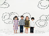 children standing  on the clouds