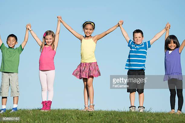 Children Standing on Top of a Hill