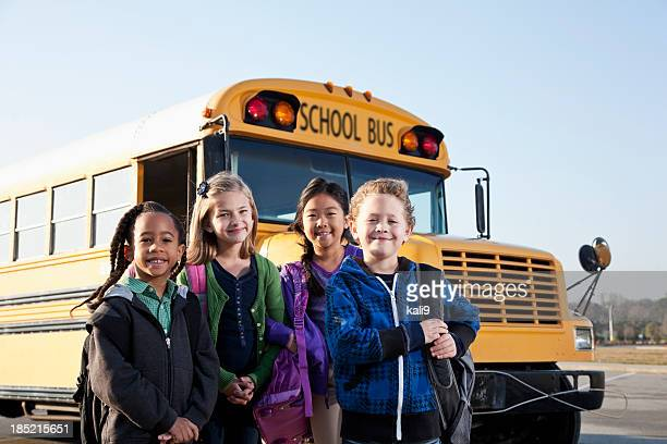 Children standing outside school bus