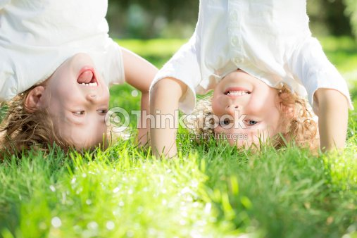 Children standing upside down : Stock Photo