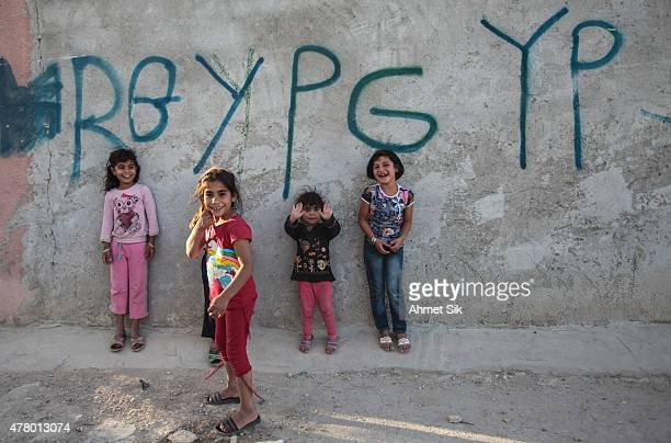Children stands near a wall in the streets of the destroyed Syrian town of Kobane also known as Ain alArab Syria June 20 2015 Kurdish fighters with...