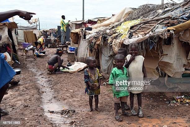 Children stant on May 3 2014 in an IDP camp near Bangui's Mpoko airport where the beginning of the rain season has worsensed the situation of people...