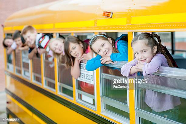 Children Sticking Their Heads Out of the School Bus