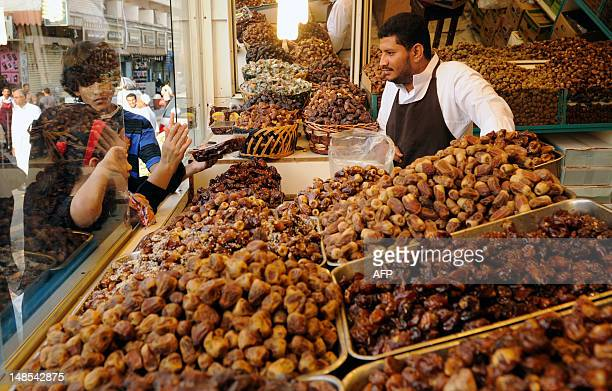 Children stop to buy dates at a store in the Saudi Red Sea port city of Jeddah on July 18 as Muslims around the world prepare for the start of the...