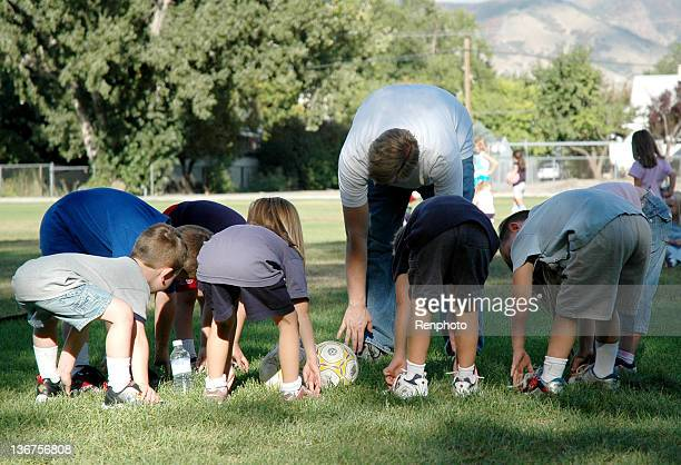 Children Stretching at Soccer Practice