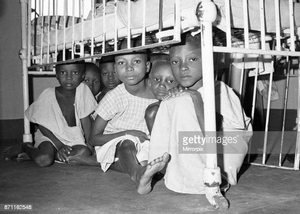 Children suffering from malnutrition hide under a cot during an air raid at Queen Elizabeth Hospital Umuahia just one of the estimated one to two...
