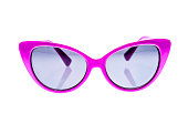 Pink Children sunglasses, sun shades or spectacles isolated on white background. Color child glasses protection from sun and UV rays. Concept of sun protection and vacation.