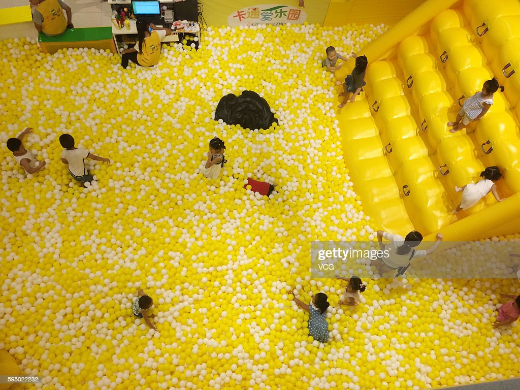 Children 'surf' in the sea of balls at a shopping mall in Qujiang District on August 24 2016 in Xi'an Shaanxi Province of China An inflatable boat...