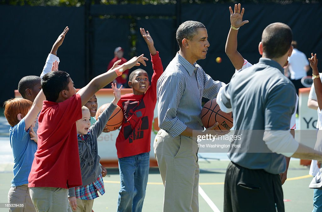 Children surround President Barack Obama during a basketball station during the annual White House Easter Egg Roll on Monday April 01, 2013 in Washington, DC. Kid President, Robbie Novak was in attendance as well as Washington Wizards players and others.