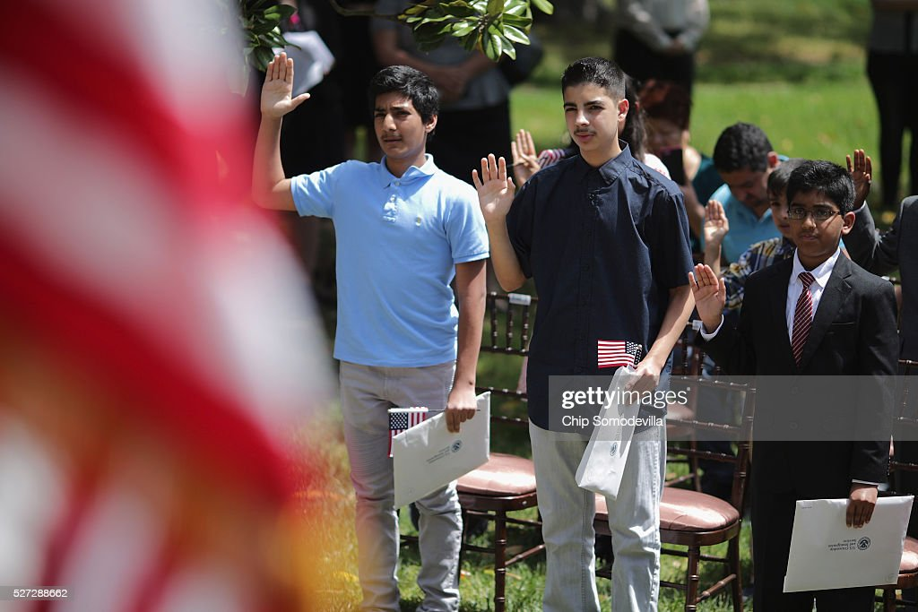 Children swear the oath of allegiance during a childrens citizenship ceremony at President Lincoln's Cottage at the Soldiers' Home May 2, 2016 in Washington, DC. Twenty one children from 19 countries, including Syria, South Korea and El Salvador, became new United States citizens during the ceremony sponsored by the U.S. Citizenship and Immigration Services. President Abraham Lincoln and his family resided seasonally on the grounds of the Soldiers' Home to escape the heat and politics of downtown Washington, as did President James Buchanan before him and presidents Rutherford B. Hayes and Chester A. Arthur from 1885 to 1887.