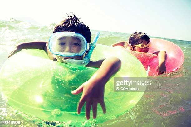 Children Swimming In The Water
