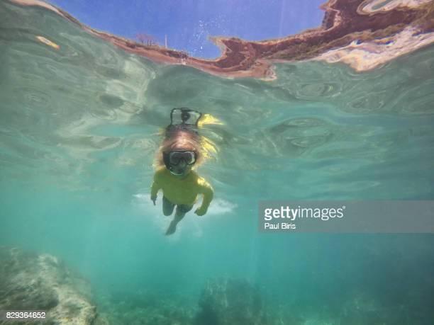 Children swimming underwater sea, Zakynthos Island, Greece
