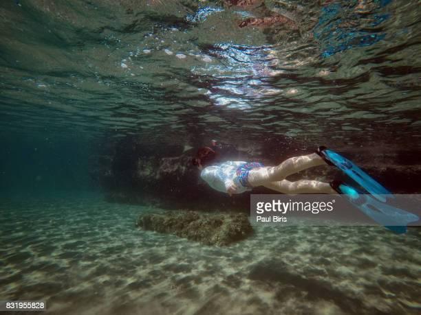 Children swimming underwater , Zakynthos Island, Greece