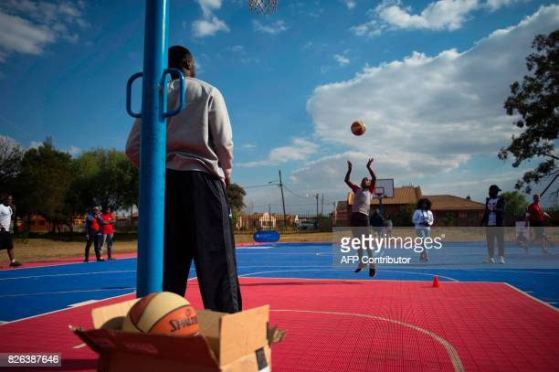 Children take part in a basketball clinic practice with NBA players from various countries on the eve of the NBA Africa Game 2017 basketball match...