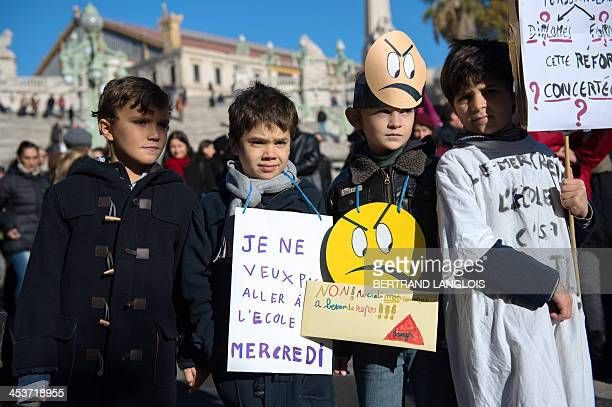 Children take part in a demonstration on December 5 2013 in Marseille southern France during a nationwide day of strike to protest against the...