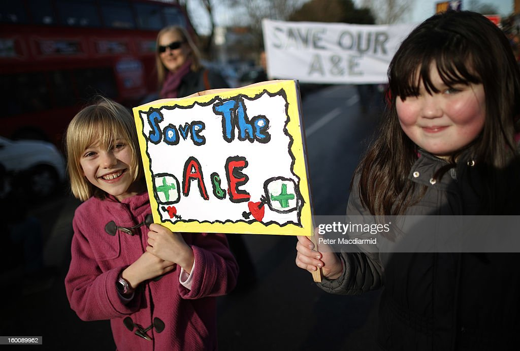 Children take part in a public demonstration against the closure of some services at Lewisham Hospital on January 26, 2013 in Lewisham, London, England. Thousands of people from around the country took part in the demonstration and rally in Lewisham today in protest against Government proposals to close Accident & Emergency, Intensive Care, maternity and children's services at Lewisham Hospital.
